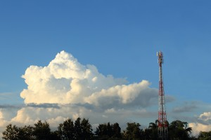 telephone tower base station among jungle in afternoon